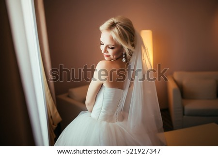 Happy bride standing with closed eyes, getting pleasure from future wedding. Thinking about future family life. Wedding is soon.