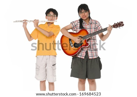 happy brother and sister studio with guitar, flute