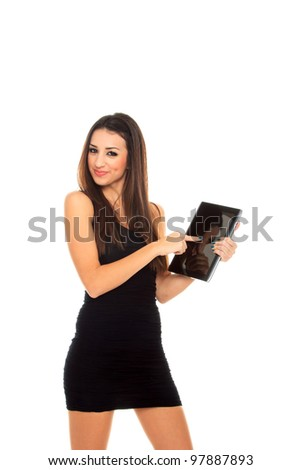 Happy brunette woman holding in hand a tablet touch pad computer and smiling on a white background