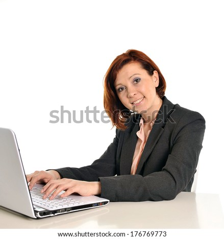 Happy business woman with red hair smiling at work writing on computer isolated on white background
