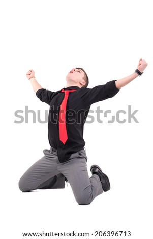 Happy businessman celebrating isolated in white
