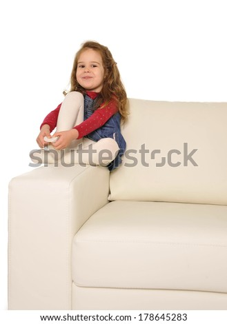 Happy caring Father and sweet  little daughter reading book on couch together