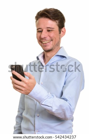 Happy Caucasian businessman smiling and holding mobile phone isolated against white background