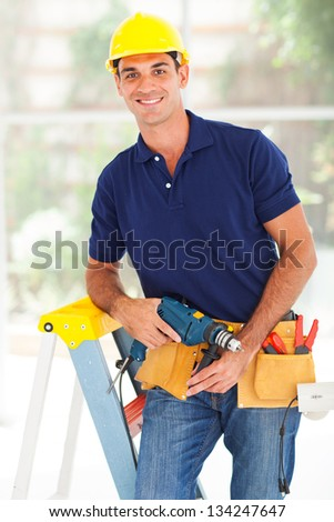 happy cctv system installer with tools