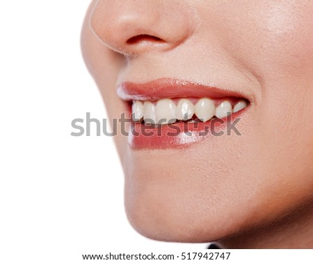 Happy cheerful girl's smile with white teeth isolated on white