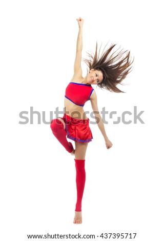 Happy cheerleader dancer from cheerleading team dancing and jumping in red blue uniform colors isolated on a white background