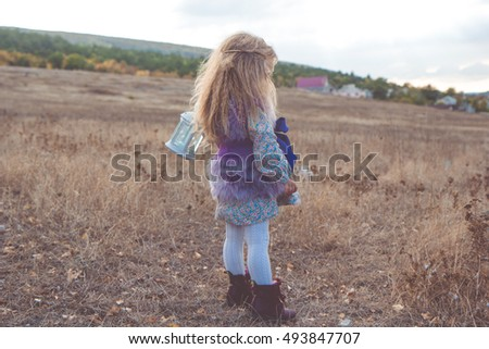 Happy child girl in autumn filed