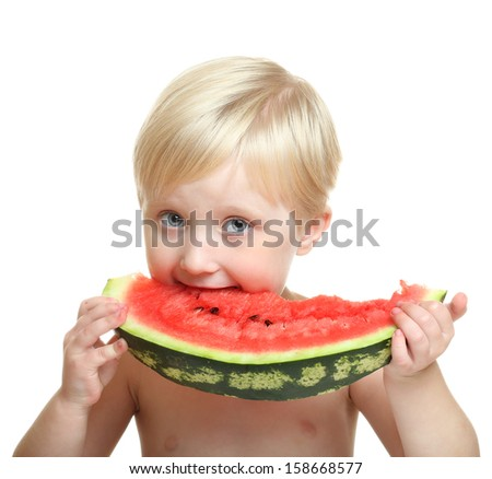 Happy child (girl, 4 years) with big red slice of watermelon. Isolated on white background. Healthy eating concept