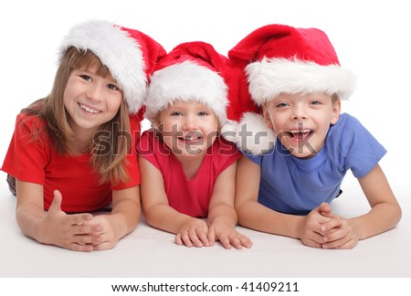 Happy child in christmas hat isolated on white