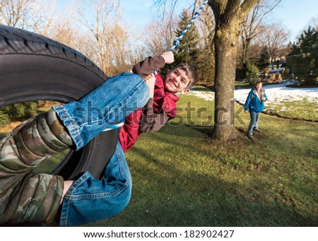 Happy Child on Tire Swing