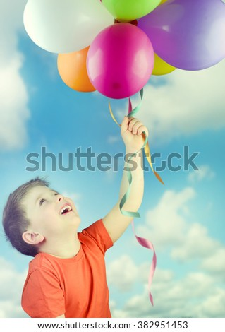 Happy child with balloons.