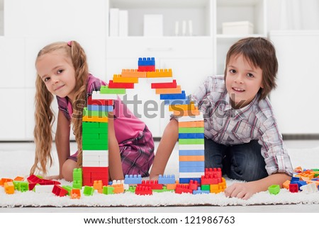 Happy children among of colorful blocks