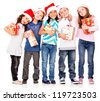 Happy children with Christmas gifts - isolated over a white background - stock photo