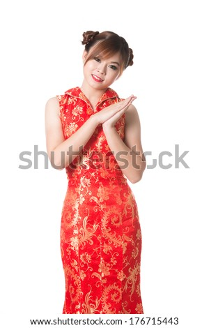 Happy Chinese new year,Smiling Chinese woman dress traditional cheongsam at New Year,studio shot isolated on white background.