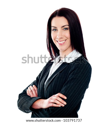Happy confident businesswoman posing with crossed arms