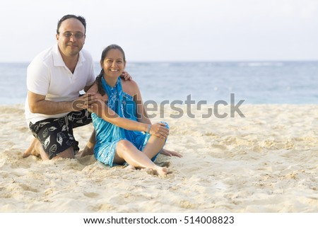 Happy Couple Enjoying at the beach in Summer