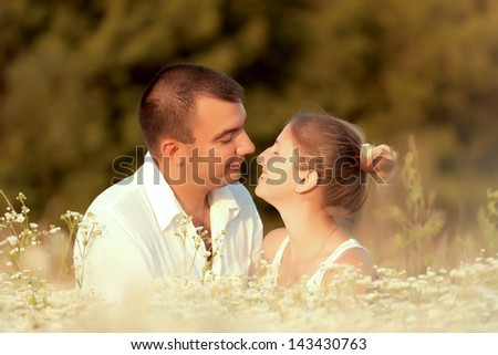 Happy couple enjoying life in the field, playing outdoors