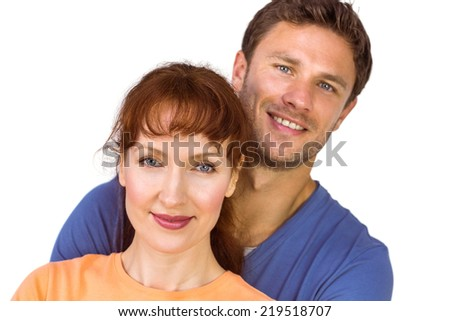 Happy couple looking at camera on white background