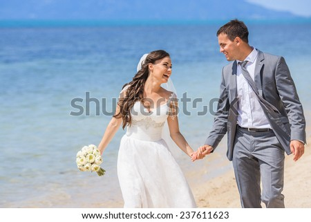 Happy couple near the blue sea