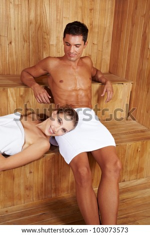 Half-naked Man And Woman Relaxing In Sauna Stock Photo