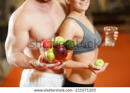 Happy couple with fruits and vegetables