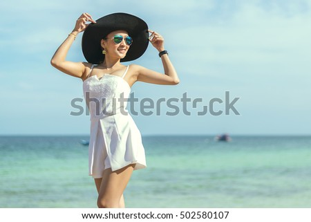 happy day beautiful young girl smile post in sea relaxing
