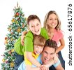 Happy family and a Christmas Tree. - stock photo