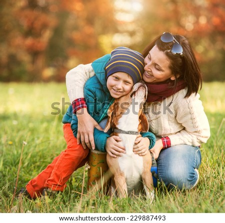 HAppy family autumn portrait - mother with son and pet