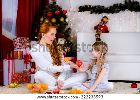 happy family home near the Christmas tree have a good time together