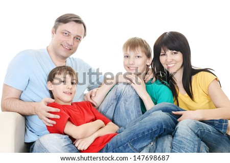 happy family in colored T-shirts resting  together