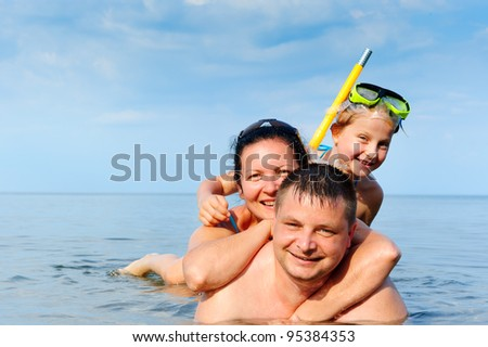 Happy family in the sea. Mum, the father and the daughter