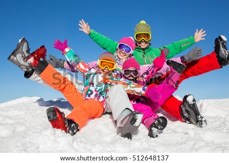 happy family in winter clothes enjoy on the snow at ski resort