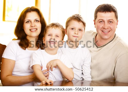 happy family indoor; shallow DOF, focus on mother eyes