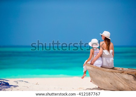 Happy family mother and little girl on the beach