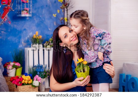 happy family. mother daughter in the room. daughter kissing mother. Mother's Day. March 8,