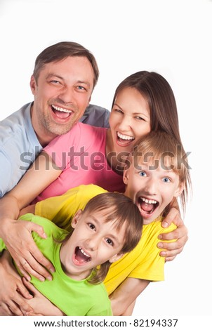 happy family of a four smiling on white
