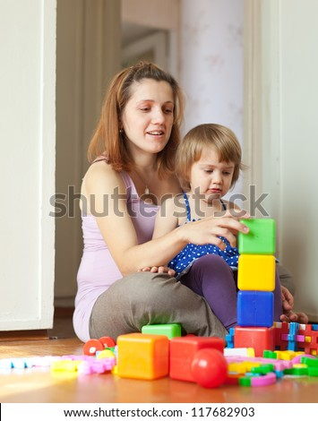Happy family plays in home interior