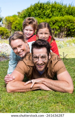 Happy family smiling at camera in the countryside