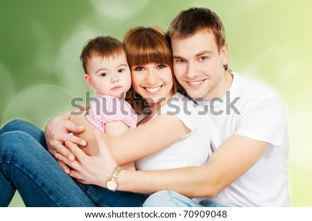 happy family with a baby on a color background