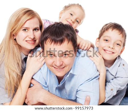 Happy family with children isolated on white background. Parents with boy and girl studio shot