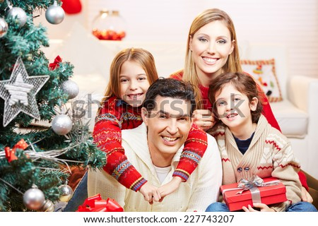 Happy family with two kids at christmas with gifts