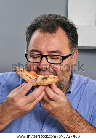 stock photo happy fat man eat pizza slice 595727483