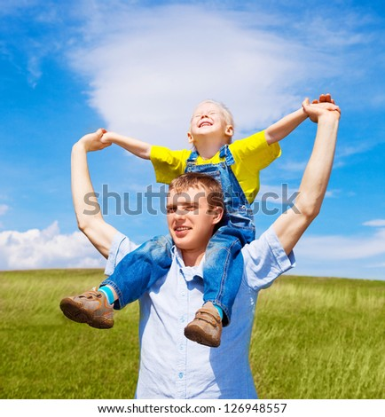 happy father and his son outdoor on a summer day