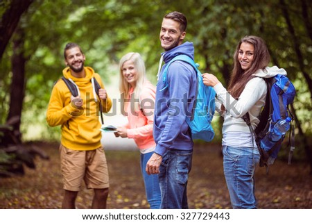 Happy friends on hike together in the countryside