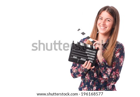 Happy girl holding a clapperboard
