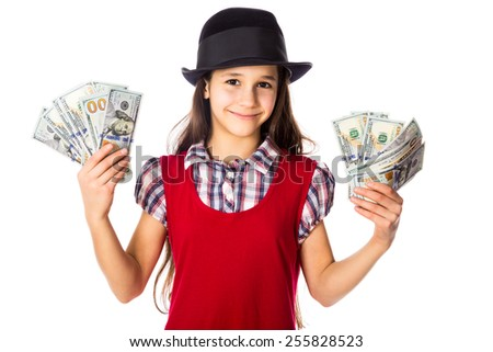 Happy girl in black hat with hundreds of dollars in hands, isolated on white