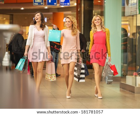 Happy girls shopping at the mall