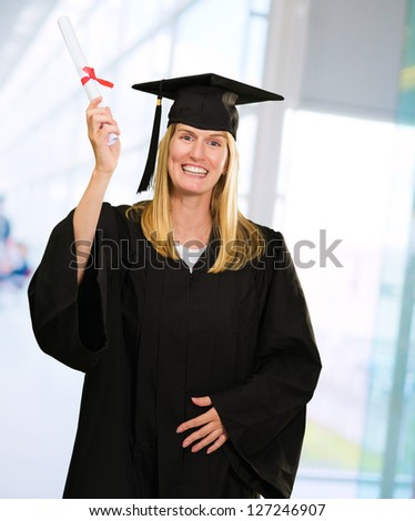 Happy Graduate Woman Holding Certificate against an abstract background