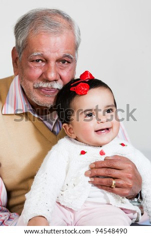 happy grandfather with grand daughter