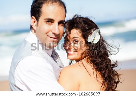 happy groom and bride on beach
